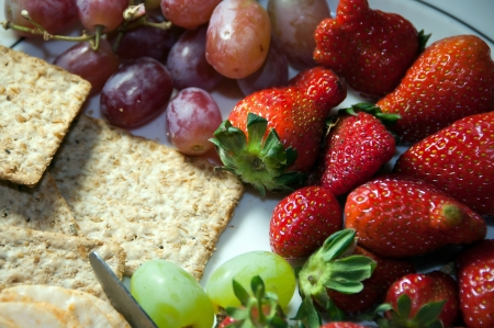 Plate of crackers and fruits Stock Photo
