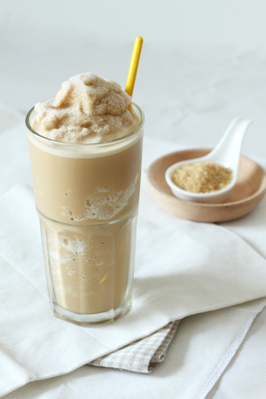 a glass of coffee and caramel smoothie photo