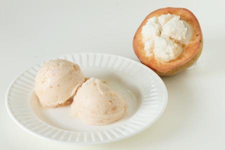 sorbet: santol sherbet ice cream scoop with fresh santol Zdjęcie Seryjne