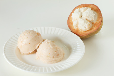 sherbet: santol sherbet ice cream scoop with fresh santol Stock Photo