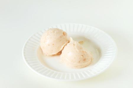 sherbet: santol sherbet ice cream scoop on white plate background