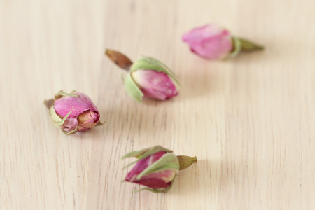 bourgeon: Flower tea rose buds on wooden table