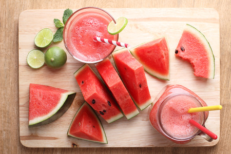 drinks: Healthy watermelon lime smoothie and fresh watermelon on a wooden background