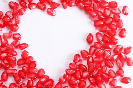 pommegranate: heart shape of pomegranate seeds Stock Photo