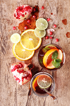 pommegranate: glass of pomegranate juice with fresh fruits on wooden table