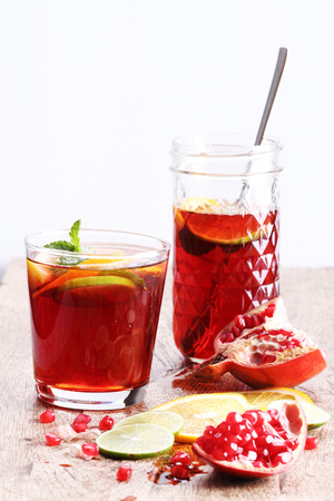 pomegranat: glass of pomegranate juice with fresh fruits on wooden table