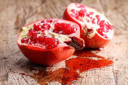pommegranate: pomegranate, red juicy pomegranates on wooden background Stock Photo