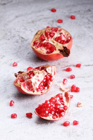 pommegranate: pomegranate, red juicy pomegranates on marble table Stock Photo