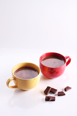 hot chocolate drink: hot chocolate drink in colorful cups on white background Stock Photo