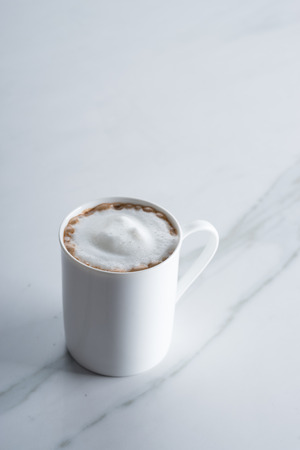 hot chocolate drink: hot chocolate drink in white mug on marble table