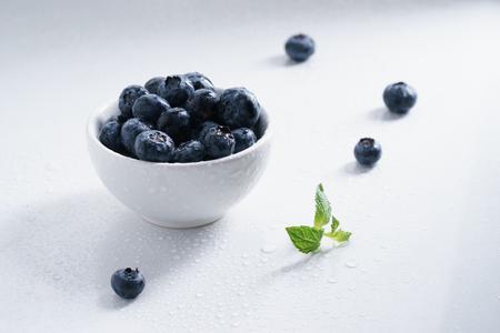 c: blueberry, fresh blueberry on white marble background