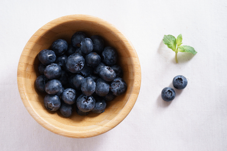 c vitamin: blueberry, fresh blueberry in wooden bowl Stock Photo