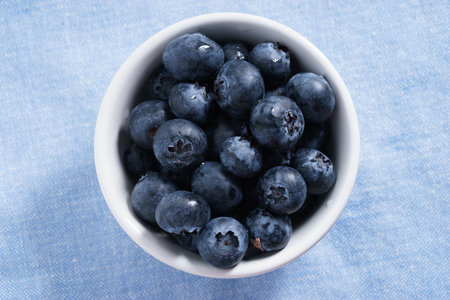 c: blueberry, fresh blueberry on blue fabric background