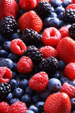 red berries: strawberries, blueberries, raspberries and black berries. fresh berries on white background