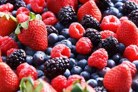raspberry: strawberries, blueberries, raspberries and black berries. fresh berries on white background
