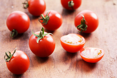 lycopene: Tomatoes. red ripe tomatoes on  wooden background.