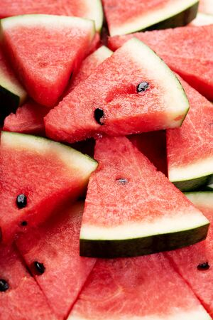 Slices of fresh watermelon covering as background