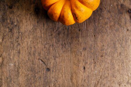 orange pumpkin on rustic wooden background