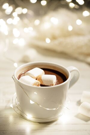 White ceramic cup of hot cocoa with marshmallows on white wooden background  Stock Photo