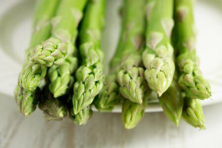 Fresh Asparagus on white