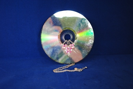 Damaged CD and necklace Stock fotó