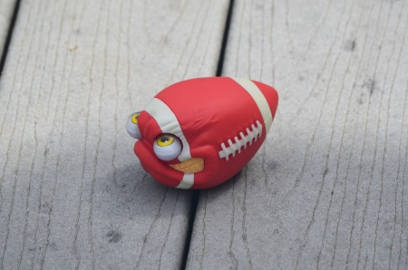 Red football with eyes