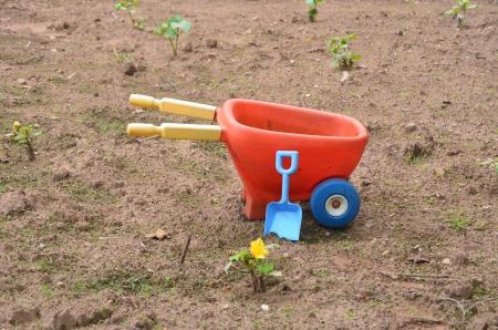 Toy wheelbarrow and shovel