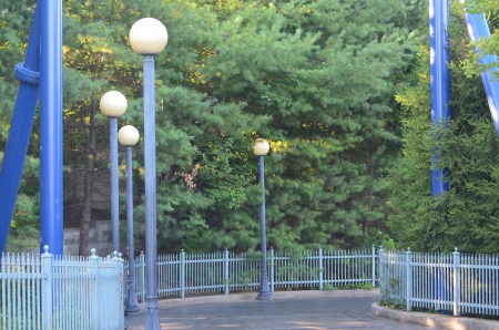 Lighted and fenced walkway