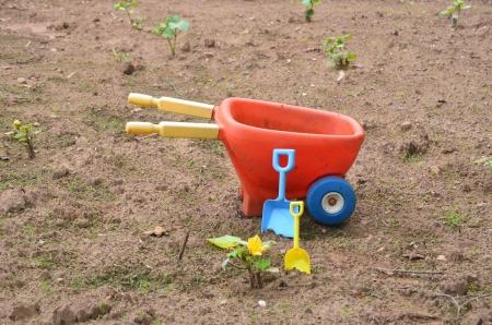 Toy wheelbarrow and shovels