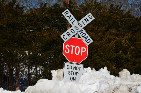 Railroad crossing sign and stop sign