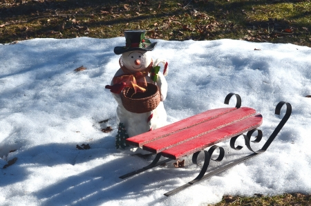 Snowman and sled photo