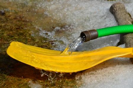 oar: Garden hose and yellow boat oar