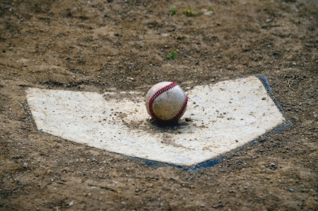 Baseball on home plate Stock Photo