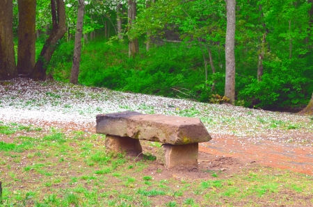 A brown stone bench