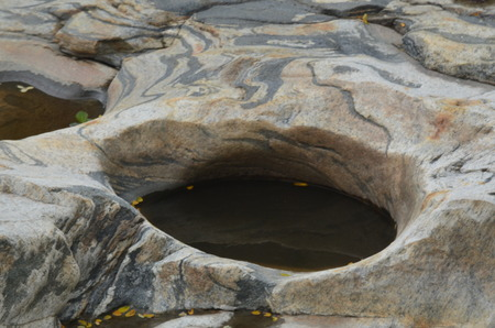 pot hole: Pot hole in granite rock