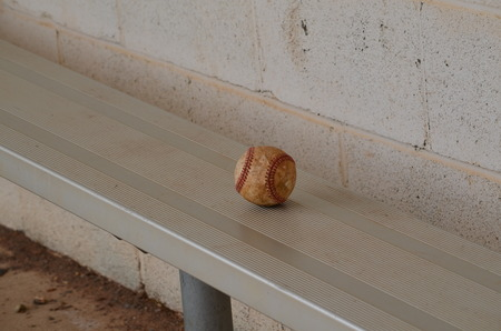 baseball dugout: Baseball on a dugout bench