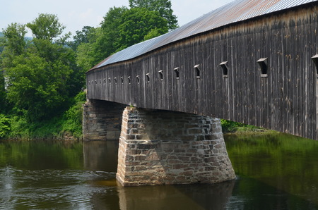 span: Covered bridge on the CT, river span from VT, to NH.