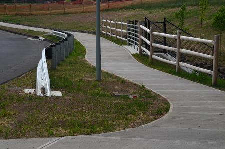 New sidewalk and fence