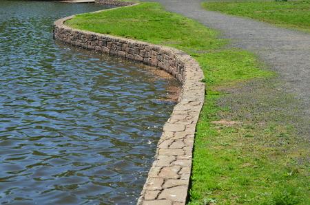 Stone wall around a pond