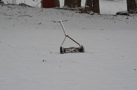Antique reel mower in snow