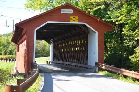 An old red covered bridge in Vermont Stock Photo