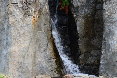 A waterfall flowing over a stone wall
