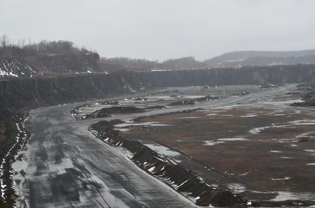 A road through a stone quarry site