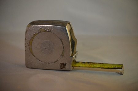 A metal tape measure with inches and feet Stock Photo