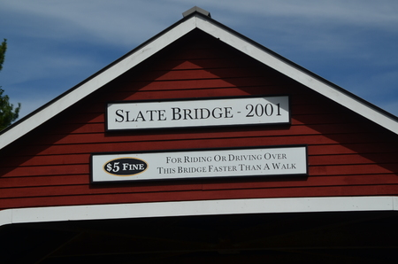 A red wooden covered bridge
