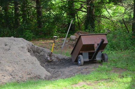 Top soil pile and shovel and trailer