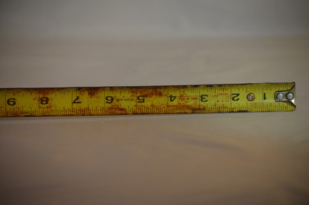 A yellow metal tape measure