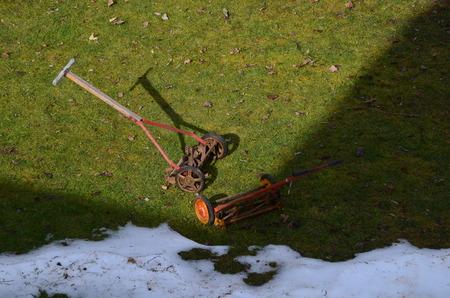 Two antique reel type push mowers Stock Photo