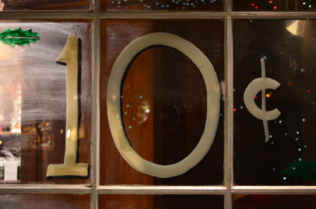 A ten cent sign in a window