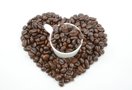 burlap bag: Coffee beans and Heart on white background
